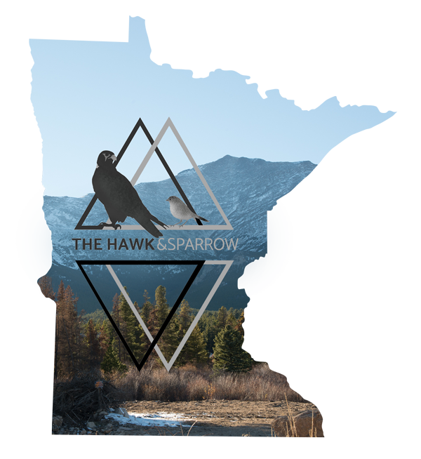 A cut out of Minnesota with a photo of mountains in Denver, Colorado and The Hawk and Sparrow Logo that represents the intimate portraits and boudoir sessions that we offer.